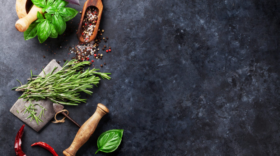 Herbs and spices cooking on stone table